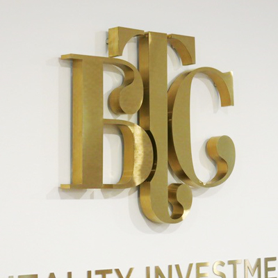 gold office logo sign
